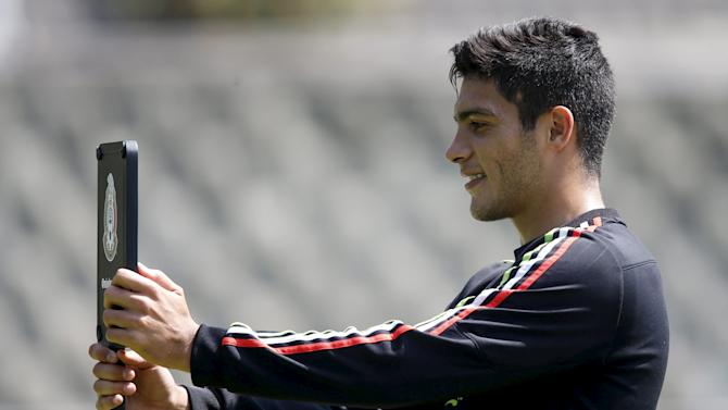 Mexico's soccer player Jimenez takes a selfie during a soccer training session in Mexico City