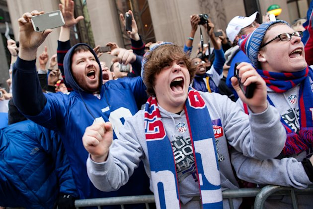 New York Giants fans cheer during the team's NFL football Super Bowl parade in New York, Tuesday, Feb. 7, 2012. The Giants returned from their Super Bowl win to a celebration the likes that only New Y
