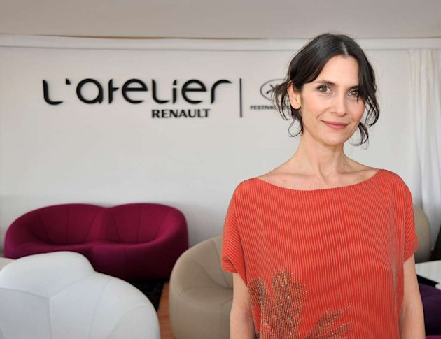 Carrie-Anne Moss poses during the 63rd Annual Cannes Film Festival on May 20, 2010 in Cannes, France. 