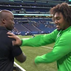 NFL Media's Akbar Gbajabiamila tests University of Southern California defensive lineman Leonard Williams' 'hand speed'