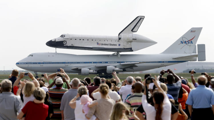 Space shuttle Endeavour sits atop NASA's Shuttle Carrier Aircraft, or SCA, Wednesday, Sept. 19, 2012, at Ellington Field in Houston. Endeavour is making a final trek across the country to the California Science Center in Los Angeles, where it will be permanently displayed. (AP Photo/David J. Phillip)