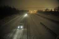 <p>               Motorists travel slowly on a snow-covered Interstate 24 during a winter storm Wednesday, December 26, 2012, in Paducah, Ky. The storm dumped several inches of snow making travel hazardous. (AP Photo/Stephen Lance Dennee)
