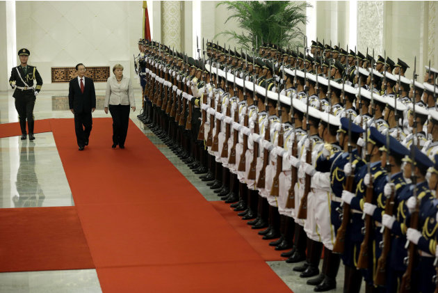 German Chancellor Angela Merkel, third from left, and Chinese Premier Wen Jiabao second from left, inspect a guard of honor during a welcome ceremony held at the Great hall of the People in Beijing Th