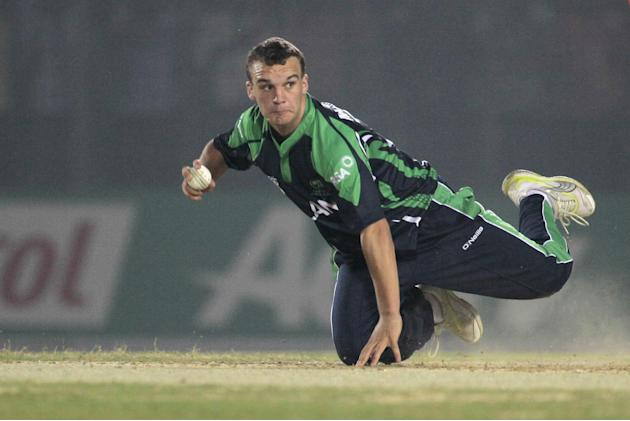 Ireland's Andy McBrine fields during a warm-up cricket match against Nepal ahead of the Twenty20 World Cup Cricket in Fatullah, near Dhaka, Bangladesh, Wednesday, March 12, 2014. (AP Photo/A.M. Ahad)