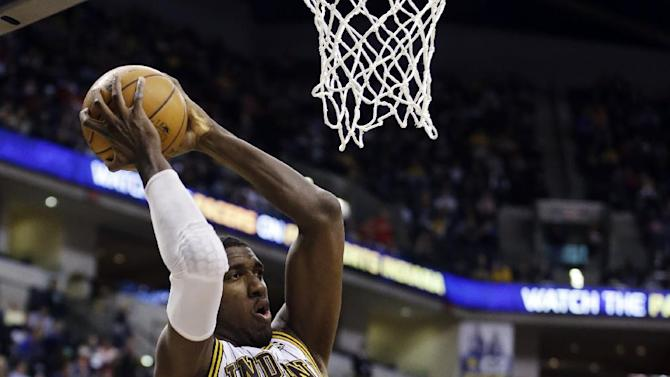 Indiana Pacers' Roy Hibbert (55) shoots against Chicago Bulls' Joakim Noah during the second half of an NBA basketball game, Sunday, March 3, 2013, in Indianapolis. Indiana won 97-92. (AP Photo/Darron Cummings)