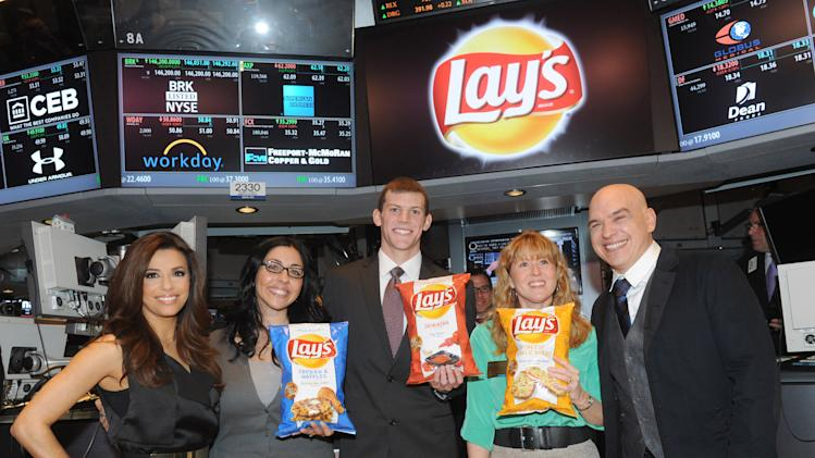 "IMAGE DISTRIBUTED FOR FRITO-LAY - The three finalists in the Lay's ""Do Us A Flavor"" contest, Christina Abu-Judom, second left, Tyler Raineri, center, and Karen Weber-Mendham, second right, are joined by actress Eva Longoria, left, and chef Michael Symon at the New York Stock Exchange, Tuesday, Feb. 12, 2013, in New York. The finalist flavors - Lay's Cheesy Garlic Bread, Lay's Chicken & Waffles and Lay's Sriracha flavored potato chips - are now available on store shelves nationwide.  (Photo by Diane Bondareff/Invision for Frito-Lay/AP Images)"