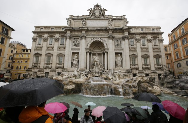 "Tourists gather at Trevi's fountain, in Rome, Monday, Jan. 28, 2013. The Fendi fashion house is financing an euro 2.12 million ($2.8 million) restoration of Trevi Fountain in Rome, famed as a setting for the film ""La Dolce Vita'' and the place where dreamers leave their coins. The 20-month project on one of the city's most iconic fountains was being unveiled at a city hall press conference Monday. (AP Photo/Gregorio Borgia)"