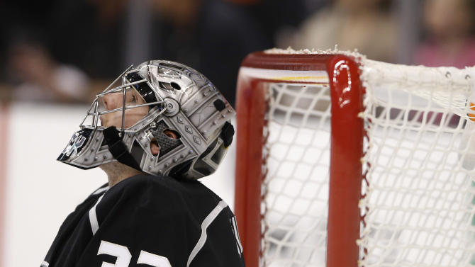 Los Angeles Kings goalie Jonathan Quick looks upward during the first period of an NHL hockey game against the Chicago Blackhawks in Los Angeles, Saturday, Jan. 19, 2013. (AP Photo/Jae C. Hong)