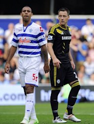 Queens Park Rangers' Anton Ferdinand (left) is seen with Chelsea's John Terry at Loftus Road in London, on September 15. erry will continue as Chelsea captain, the English Premier League club's chairman Bruce Buck said