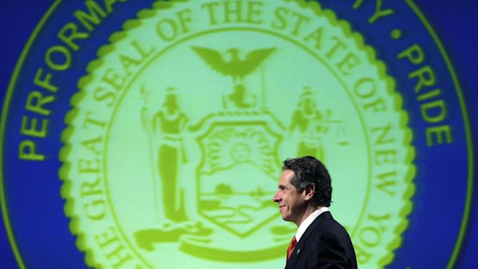 New York Gov. Andrew Cuomo walks to the podium to deliver his third State of the State address at the Empire State Plaza Convention Center on Wednesday, Jan. 9, 2013, in Albany, N.Y. (AP Photo/Mike Groll)