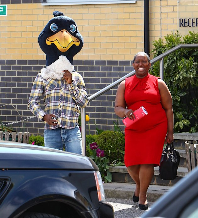 Jermain Defoe (wearing the cockerel mascot head) with his mother