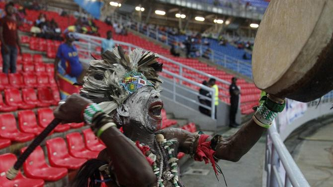 A Democratic Republic of Congo fan cheers for his team during their Group B soccer match against Tunisia at the 2015 African Cup of Nations in Bata