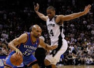 Oklahoma City Thunder&#39;s Derek Fisher (L) and San Antonio Spurs&#39; Gary Neal during game one of the NBA Western Conference Finals on May 27. The Spurs&#39; 101-98 win moved them one game closer to booking their berth in the NBA Finals
