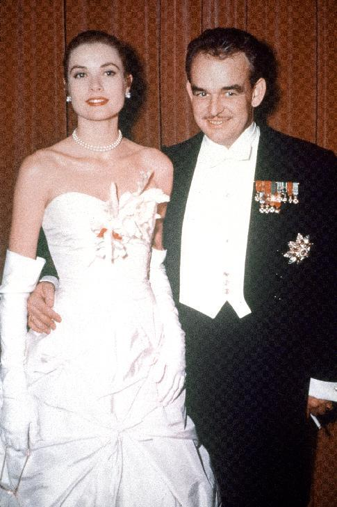 FILE - This Jan. 9, 1956 file photo shows American actress Grace Kelly, left, with Prince Rainier of Monaco. Pennsylvania's James A. Michener Museum is hosting an exhibit that traces the Kelly's life from growing up in Philadelphia to starring in films and marrying Prince Rainier III. It opens at the museum on Oct. 31 and runs through Jan. 26, 2014. (AP Photo, file)
