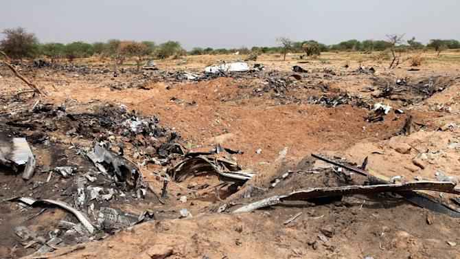 Wreckage from the Air Algerie flight AH5017 that crashed in northern Mali lays scattered at the site on August 2, 2014
