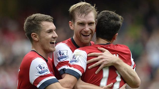 Aaron Ramsey, Per Mertesacker (Reuters)