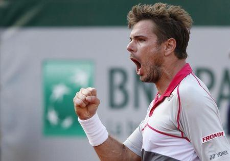 Stan Wawrinka of Switzerland reacts during his men's quarter-final match against his compatriot Roger Federer during the French Open tennis tournament at the Roland Garros stadium in Paris