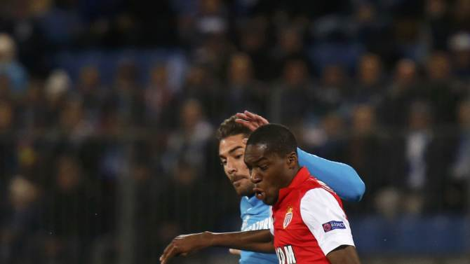 Zenit St. Petersburg's Javi Garcia fights for the ball with AS Monaco's Geoffrey Kondogbia during their Champions League soccer match at the Petrovsky stadium in St. Petersburg