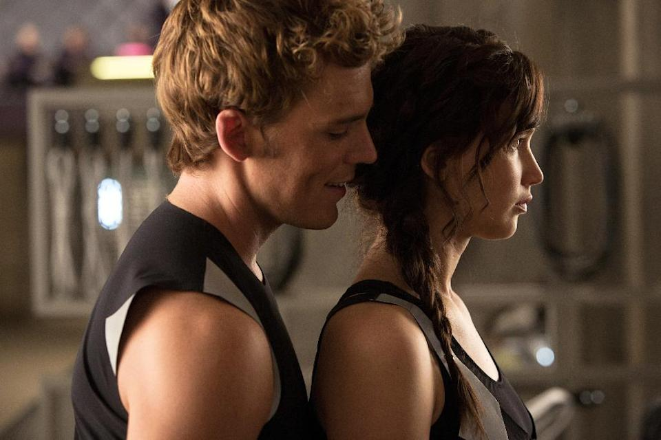 "This film image released by Lionsgate shows Sam Claflin, left, and Jennifer Lawrence in a scene from ""The Hunger Games: Catching Fire."" (AP Photo/Lionsgate, Murray Close)"