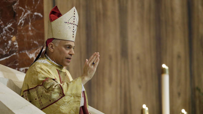 Salvatore J. Cordileone gives a blessing sing during a ceremony to install him as the new archbishop of San Francisco at the Cathedral of St. Mary of the Assumption in San Francisco,  Thursday,  Oct. 4, 2012. (AP Photo/Marcio Jose Sanchez, Pool)