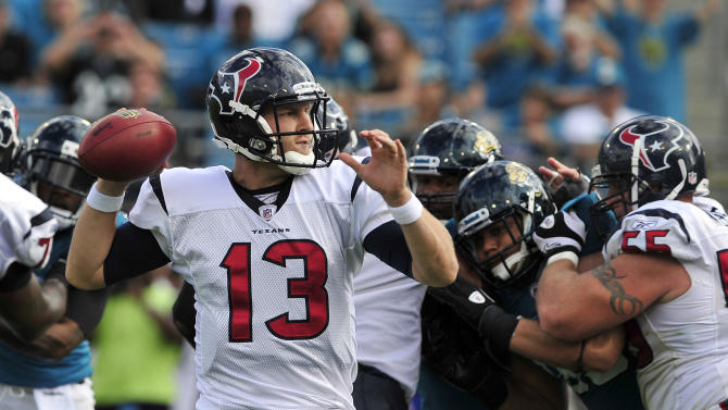 Houston Texans quarterback T.J Yates (13) throws a pass during the first half of an NFL football game against against the Jacksonville Jaguars, Sunday, Nov. 27, 2011, in Jacksonville, Fla. (AP Photo/Stephen Morton)
