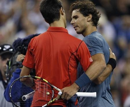 Rafael Nadal of Spain is congratulated by Novak Djokovic of Serbia (L) after his victory in their men's final match at the U.S. Open tennis championships in New York, September 9, 2013. REUTERS/Eduardo Munoz
