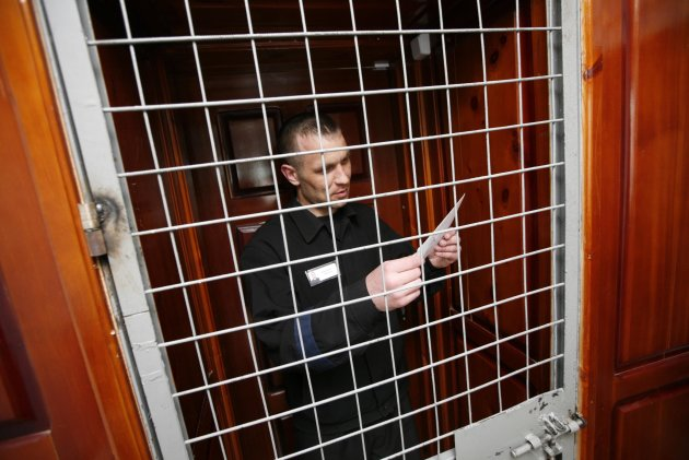 Inmate Boris Kovalyov, 32, stands inside a cell as he receives a letter from his wife at a high-security male prison camp outside Russia's Siberian city of Krasnoyarsk