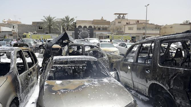 Damaged cars are seen after a car exploded near a Shi'ite mosque in Saudi Arabia's Dammam