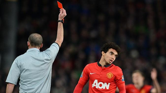 Manchester United's Brazilian defender Fabio (R) is given a red card by referee Michael Dean during the English FA Cup third round football match between Manchester United and Swansea City at Old Trafford in Manchester