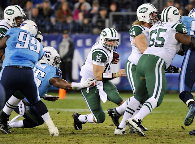 NASHVILLE, TN - DECEMBER 17:   Quarterback Tim Tebow #15 of the New York Jets is sacked by Zach Brown #55 of the Tennessee Titans at LP Field on December 17, 2012 in Nashville, Tennessee.  (Photo by Frederick Breedon/Getty Images)