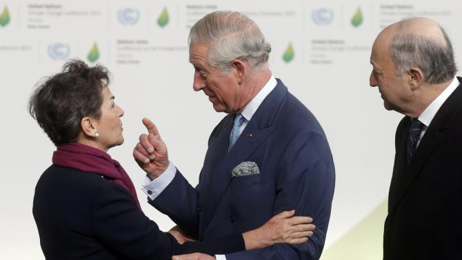 Secretary of the UN Framework Convention on Climate change Figueres welcomes Britain's Prince Charles as French Foreign Affairs Fabius looks on for the opening day of the World Climate Change Conference 2015 (COP21) at Le Bourget