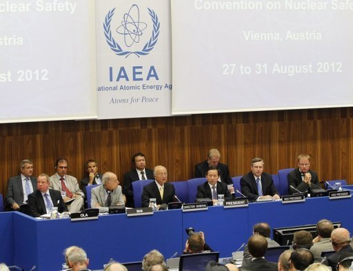 <p>The director general of IAEA Yukia Amano (Front 3rdL) and other officials are pictured during the opening ceremony of a convention in August 2012 in Vienna. The agency's board approved with a crushing majority Thursday a resolution criticising Iran brought by world powers that was also aimed at dissuading Israel from military action.</p>