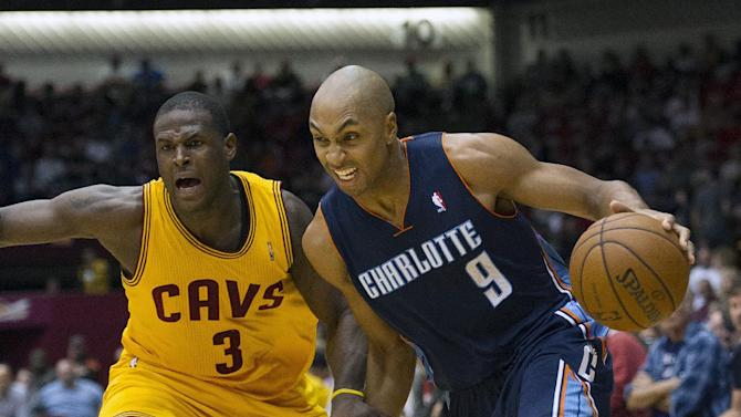 Charlotte Bobcats guard Gerald Henderson (9) drives past Cleveland Cavaliers defender Dion Waiters during the second quarter of an NBA preseason basketball game in Canton, Ohio on Tuesday, Oct. 15, 2013