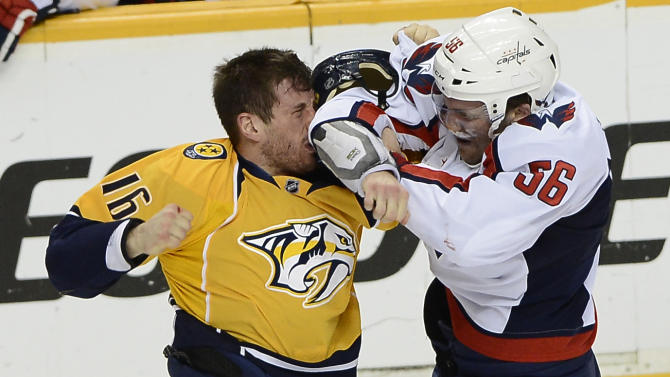 Nashville Predators forward Rich Clune (16) fights with Washington Capitals defenseman Patrick Wey (56) in the first period of an NHL hockey game on Sunday, March 30, 2014, in Nashville, Tenn