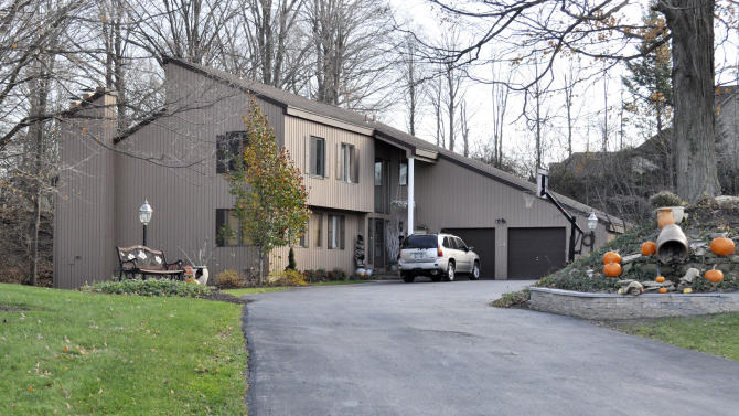 The home of Bernie Fine, Syracuse University men's basketball associate head coach, is shown in DeWitt, N.Y., Friday, Nov. 18, 2011. Fine was placed on administrative leave, Thursday, Nov. 17,  after old child molesting allegations resurfaced. (AP Photo/Kevin Rivoli)