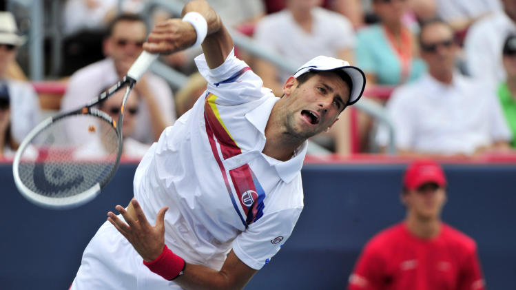 Novak Djokovic, from Serbia, returns to Mardy Fish, from the United States, during the men's final at the Rogers Cup tennis tournament, Sunday Aug. 14, 2011, in Montreal. (AP Photo/The Canadian Press, Paul Chiasson)