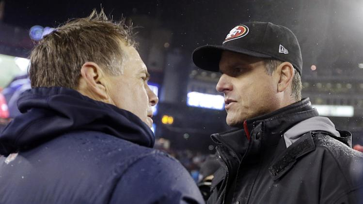 New England Patriots head coach Bill Belichick, left, and San Francisco 49ers head coach Jim Harbaugh, right, meet at midfield after an NFL football game in Foxborough, Mass., Monday, Dec. 17, 2012. The 49ers won 41-34. (AP Photo/Elise Amendola)