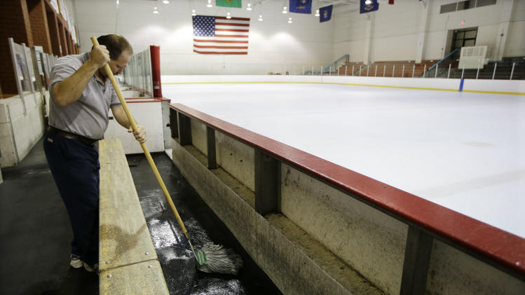 Tim Wilson cleans around a vacant Nashville Predators practice rink on Monday, Sept. 17, 2012, in Nashville, Tenn. The NHL locked out its players at midnight Saturday, the fourth shutdown for the NHL since 1992. (AP Photo/Mark Humphrey)
