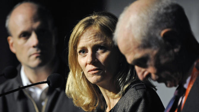 Mary Wittenberg, president of the New York Road Runners, speaks during a news conference Friday, Nov. 2, 2012, in New York, after New York Mayor Michael Bloomberg canceled Sunday's New York City Marathon. At left is Howard Wolfson, deputy mayor for government affairs and communication; at right is George Hirsch, chairman of the board of New York Road Runners. Bloomberg canceled the race after mounting criticism that this was not the time for a race, as the city continues to recover from Superstorm Sandy. (AP Photo/Louis Lanzano)