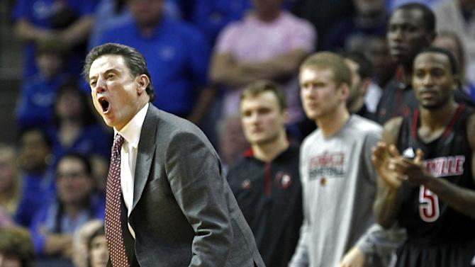 Louisville head coach Rick Pitino cries out during the second half of an NCAA college basketball game against Memphis on Saturday, Dec. 15, 2012, in Memphis, Tenn. Louisville won 87-78. (AP Photo/Lance Murphey)