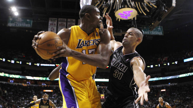 Los Angeles Lakers' Andrew Bynum (17) looks to pass around Miami Heat's Shane Battier (31) during the second half of an NBA basketball game on Thursday, Jan. 19, 2012, in Miami. The Heat defeated the Lakers 98-87. (AP Photo/Lynne Sladky)