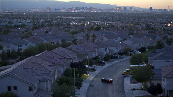 In this Wednesday, May 29, 2013, photo a motorist pulls into the driveway in a neighborhood in Henderson, Nev. Freddie Mac reports on mortgage rates for this week Thursday June 20, 2013. (AP Photo/Julie Jacobson)