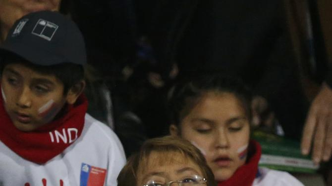 Chilean President Michelle Bachelet attends the Copa America 2015 semi-final soccer match between Peru and Chile at the National Stadium in Santiago