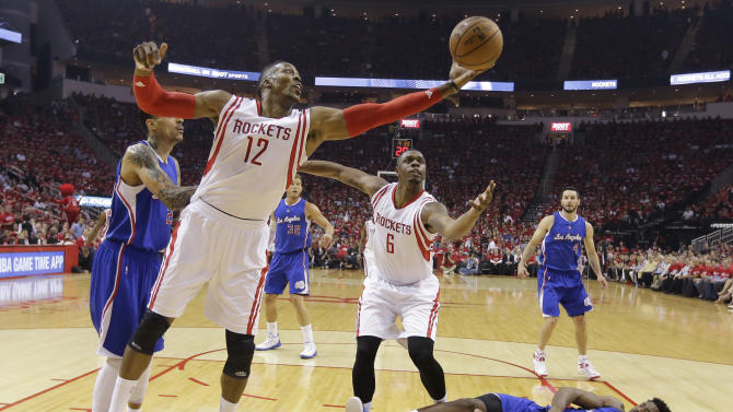 Houston Rockets' Dwight Howard (12) and Terrence Jones (6) reach for a rebound over Los Angeles Clippers' DeAndre Jordan (6) during the first half of Game 2 in a second-round NBA basketball playoff series, Wednesday, May 6, 2015, in Houston. (AP Photo/David J. Phillip)