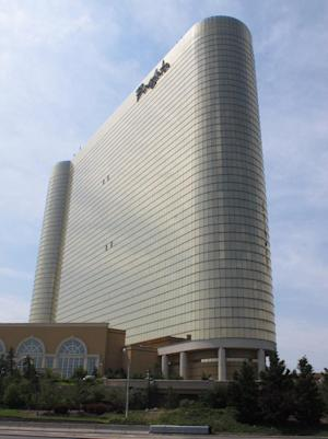 FILE - This June 26, 2013 file photo shows the Borgata Hotel Casino & Spa in Atlantic City, N.J. The casino and state gambling regulators suspended a poker tournament at the Borgata on Jan. 17, 2014 amid an investigation into whether someone used counterfeit gambling chips. (AP Photo/Wayne Parry)