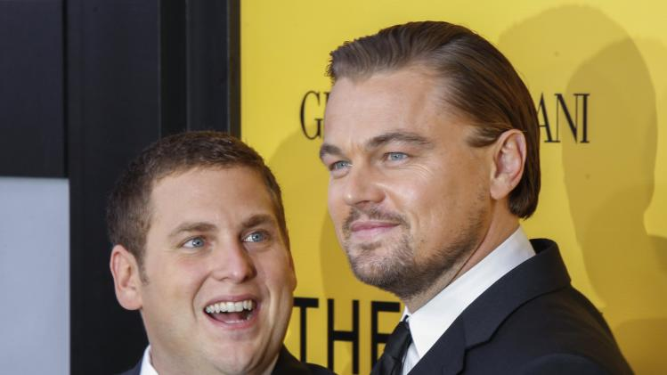 "Cast members Leonardo DiCaprio and Jonah Hill arrive for the premiere of the film ""The Wolf of Wall Street"" in New York in this file photo"