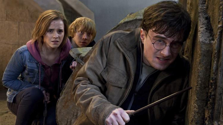 "FILE-   In this file film publicity image released by Warner Bros. Pictures, from left, Emma Watson, Rupert Grint and Daniel Radcliffe are shown in a scene from ""Harry Potter and the Deathly Hallows: Part 2.""   (AP Photo/Warner Bros. Pictures, Jaap Buitendijk, File)"