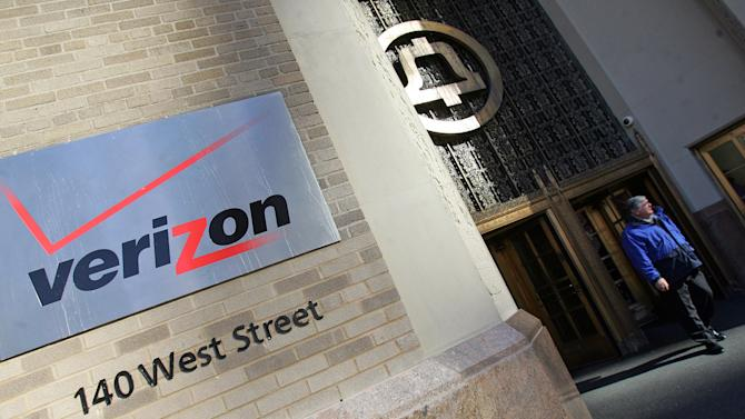 """FILE- In this Dec. 8, 2005, file photo, a man walks out the Verizon's new corporate headquarters.The Obama administration on Thursday, June 6, 2013, defended the government's need to collect telephone records of American citizens, calling such information """"a critical tool in protecting the nation from terrorist threats."""" Britain's Guardian newspaper reported that the NSA has been collecting the telephone records of millions of Verizon customers under a top secret court order. (AP Photo/Dima Gavrysh, File)"""