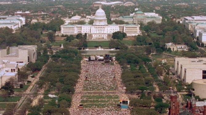 FILE - In this April 25, 1993 file photo, an estimated 300,000 people gather for the National March on Washington for Gay and Lesbian Rights in the U.S. capital. (AP Photo/Mark Wilson, File)