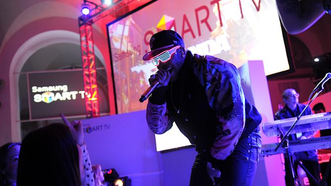IMAGE DISTRIBUTED FOR CLIENT NAME - Hip-hop artist Flo Rida performs at a launch event for the new line of 2013 Samsung Smart TVs, Wednesday, March 20, 2013, in New York. Samsung's new line allows the viewer to discover more of the TV they love with a smarter and more personalized experience.  (Photo by Diane Bondareff/Invision for Samsung/AP Images)